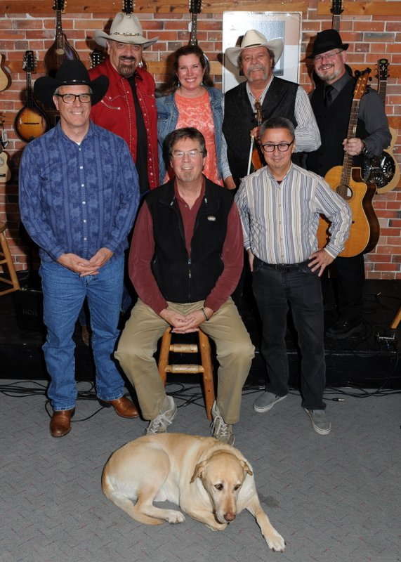 left to right. back: Jon Chandler, Mary Beth Cross, Johnny Neill, Mike Engberg;  front: Jeff Graves, Kit Simon, Ernie Martinez;  floor:  Toby the wonder dog