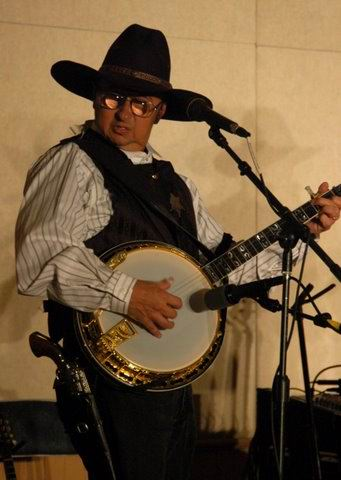 cowboy playing banjo: Ernie Martinez:                           Bands, Singers, Songwriters / Composers, Solo                           Performers, Sidemen, Instrumentalists,                           Performers, Entertainers, Musicians